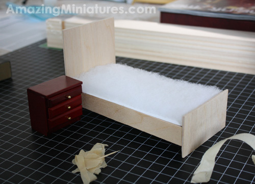 The dollhouse miniature modern bed frame fully assembled