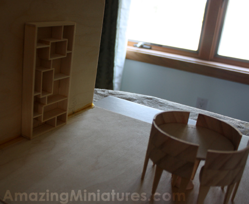 Testing out the modern dollhouse miniature bookcase in an unfinished scene