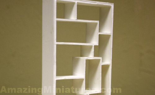 A close up of the rough cast - Modern Dollhouse Bookcase